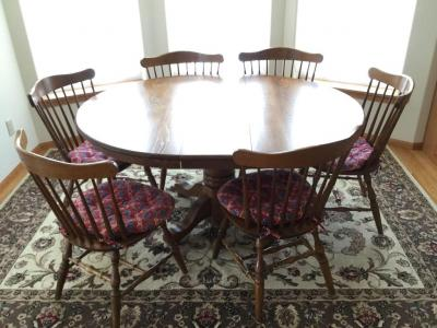 Dining room table 48 inches round With 2-12 inch leaves and six chairs. one chair does have one dowel removed but is able to be repaired