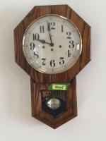 Regulator school house style clock does have a key made by Howard Miller