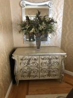 "Sideboard 50""L x 24""W x 34""H Mirror is 32 x 48 Floral arrangement is included"