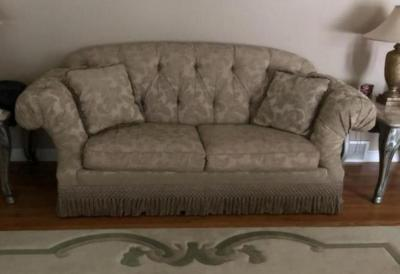 "Sofa by Thomasville, 86"". Stand with floral arrangement."