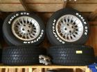 Set of 4 P235 60 R 15 Goodyear Eagle GT raised white letter tires on Ford rims
