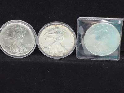 Three silver eagle dollar coins - 1993, 1994 and 1995
