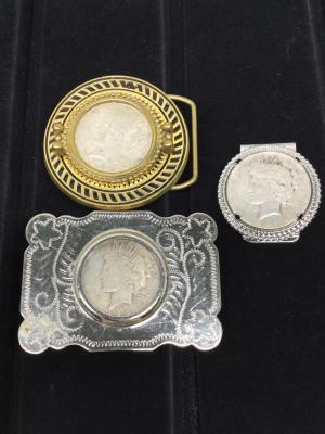 Two belt buckles and money clip with Peace Silver dollar mountings - Two 1922, 1923