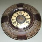"36 inch wide ""leather looking"" wall clock"