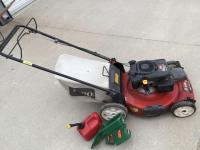 Toro recycler 22 inch self-propelled lawnmower 6.75 torque 149 cc Kohler engine With rear bagger, gas can and hand seed spreader