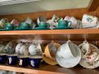 Two shelves full of china cups and saucers