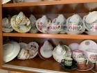 Two shelves of china cups and saucer