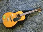 Small six string guitar
