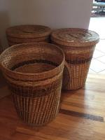 Three large wicker baskets with lids
