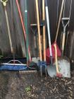 Post hole digger, Ax, shovels, rakes, and broom