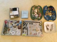 Assorted necklaces, earrings, brooches, lapel pins, bracelets, empty jewelry boxes