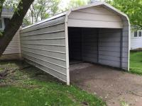 "One car aluminum carport with back door, 8.5 ft tall, (6ft tall opening), 21ft long, 10' 2"" wide"