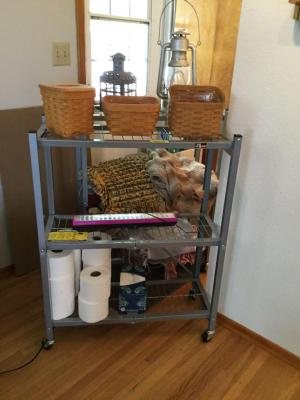 Two 3-shelf rolling racks, Longaberger baskets, lanterns, various throws & rugs, LED light