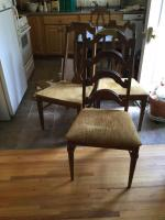 Kitchen table with two drop leaves, four chairs. Table also comes with 3 extra leaves.