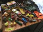 Vintage children's toys---various rolling toys, tin tops & army cars. See all photos