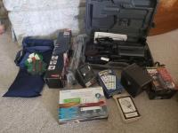Video camera, tripod, space heater, games & handheld wand scanner.