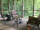 Five piece patio set: two chairs, bench, three drawer shelf, side table & rug. Great condition!