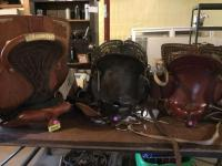 2 pony saddles and 1 adult saddle in good shape. See photos