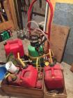 Gas cans, weed eater parts, small dolly, wee spray bottle