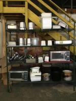 Shelving w/ contents-2 Sharp microwave commercial ovens, chafing pans, misc. utensils See all photos