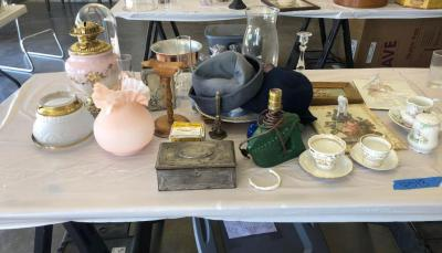 Glassware, vintage hats, glass display dome, oil lantern parts & framed art. Please see all photos