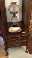 Walnut parlor table with one drawer, Victorian lamp, and Nippon plate