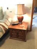 "End table w/ 2 doors, lamp, GE alarm clock Table measures 28""L x 28""W x 21""H"