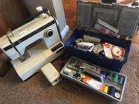 Montgomery Wards electric sewing machine and accessories