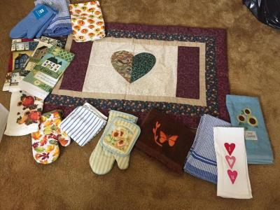 Table quilt top, new kitchen linens, pot holders, towels