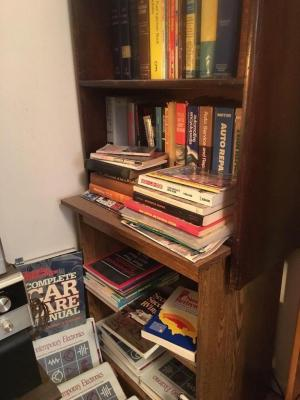 Two single shelf bookcase with books