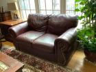 "Burgundy loveseat is a match to the previous lot, 62"" long with gold grommets."