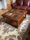 Coffee table measuring  38 x 38 x 20 with leaded glass top inserts