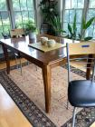 Dining room table with four chairs Table measures 60 x 42. Condition appropriate for age Contents excluded One chair has damage