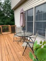 Glass top round patio table measures 38 inches round with four chairs and an umbrella