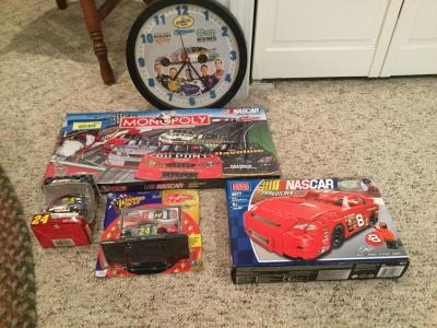 NASCAR collectors items-dale Earnhardt Jr., Jeff Gordon featuring the Sam Bass collection, Rousch Racing Clock, Monopoly game still unopened.