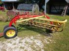 New Holland roll a bar 256 side rake with Dolly wheel front