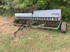 12 foot John Deere green drill with grass seed boxes