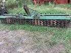 John Deere 12' three point hitch cultipacker with 20 inch front wheels and two bars of tines. This would be handy!