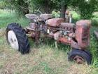 Farmall C tractor for parts non-running sitting for years concrete weights poured in rear rims serial number 162634