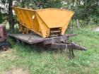 Highway equipment brand 11 foot spreader box Sitting on a steel deck 7 1/2' x 14' dual wheeled single axle trailer