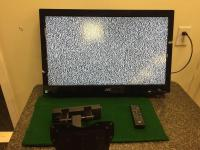 "JVC 32"" TV with remote, wall mount bracket included"