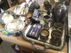 Variety of chrome and silver plate items includes covered butter,  iced tea spoons and more