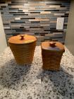 Two Longaberger baskets- one with wire bail handle