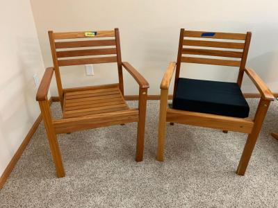 2 Carraro wood slatted arm chairs, 1 does come w a comfy pad