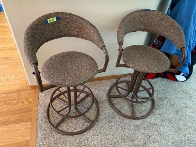 2 matching counter height padded brown stools...they swivel!!!