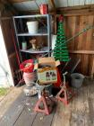 All items in shed corner-shelf, jack stands, fish bowl, dog toys, yard art, outdoor wall lantern (box says 2, but there is only 1)