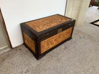 "Intricately carved storage chest Measures 40"" x 21"" x 20"" Legs are not attached, but are in the trunk"