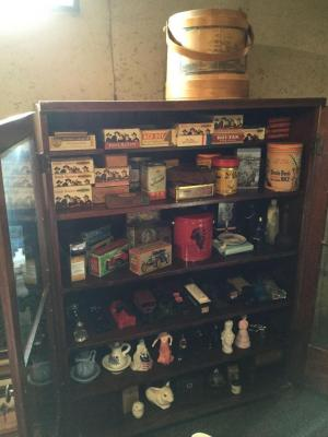 All items in cabinet and on top include Avon bottles, many cigar boxes, tins and sugar bucket with nautical design