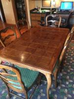 Dining room table (39x62). Includes 6 chairs and 2 leaves. Table may need to be refinished if using leaves as discoloration has occured. LOCATION: KIT