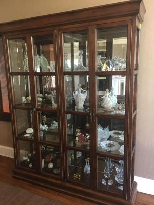 62x81x15 beveled glass 4 door display cabinet with glass shelves,mirrored back and side lights *Contents not included*LOCATION: LIVING ROOM